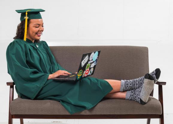 Graduate with computer (NMU stock photo)