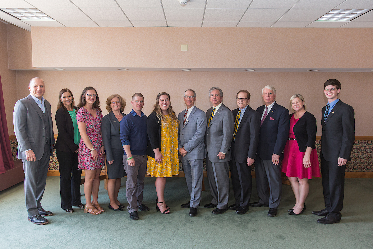 From left: NMU Trustees Rick Popp and Lisa Fittante; Samantha Black; Trustee Tami Seavoy; Joseph Roberts; Meghan Hohenstein; Board Chair Bob Mahaney and Vice Chair Steve Mitchell; Trustees James Haveman and Alexis Hart; and Adam Kall.