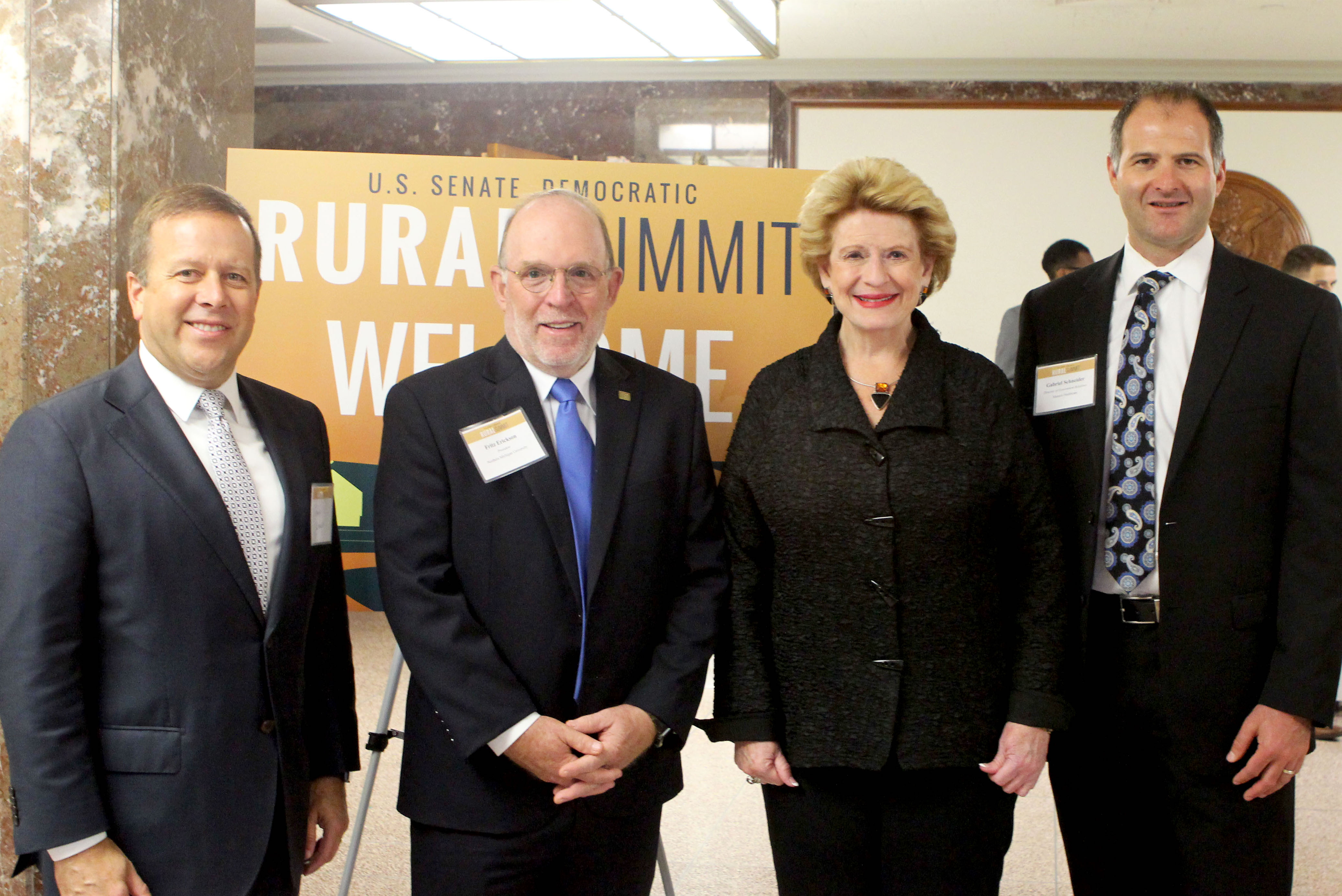 From left: Gavin Leach and Fritz Erickson from NMU, Sen. Debbie Stabenow and Gabriel Schneider of Northern Strategies 360 in Traverse City (the other Michigan attendee invited).