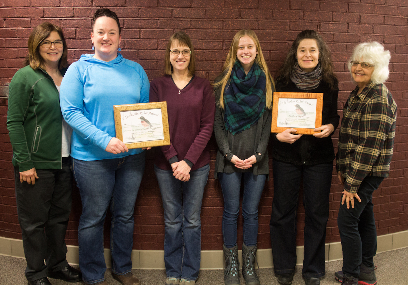 Pictured, left to right, are Sharon Carey, Director of NMU Dining Services; Sarah Derwin, health educator, MCHD; Laura Fredrickson, HIV/AIDS coordinator, MCHD; Kate Rozeveld, president of the NMU Health Promotion Society, the student group that sponsored the event; Natasha Lantz, Northern Vegans; and Barb Coleman, health fair coordinator.