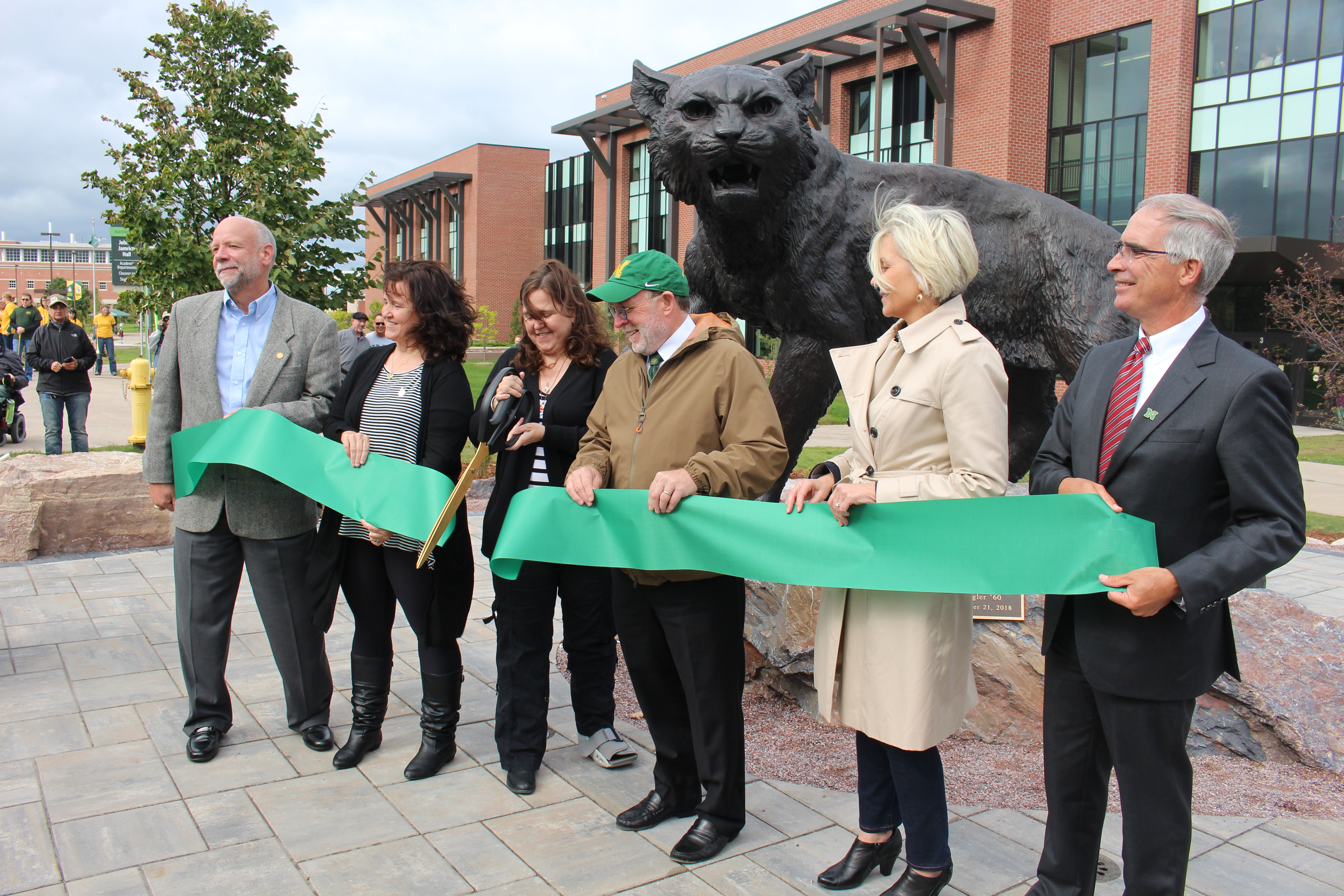 Ribbon-cutting with (from left) NMU Foundation Board President Mark Pynnonen; Ziegler\'s daughters Kelly and Wendy; NMU President Fritz Erickson; Alumni Board President Susan Bilkey; and NMU Board of Trustees Chair Robert Mahaney