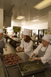Students cooking in an NMU kitchen