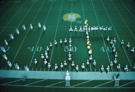 NMU marching band forming the word Cats