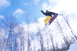 Snowboarder  jumping overhead