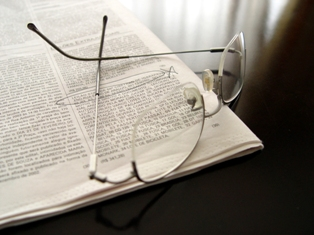 Glasses sitting on newspaper