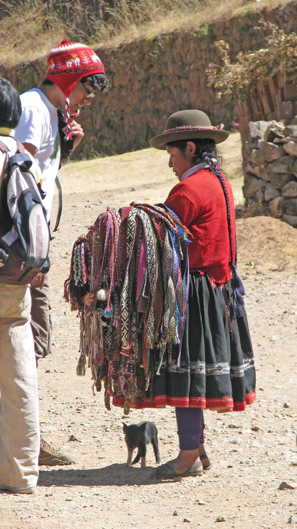 Student buying belt from Peruvian resident