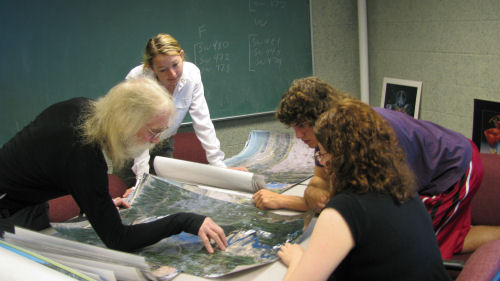 Dr Carroll and students study map of Yellow Dog River