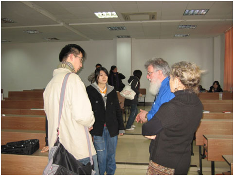 Ira and Barb Hutchison converse with Chinese students