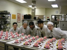 culinary students with food