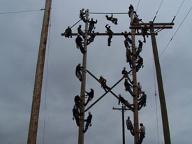 men on pole