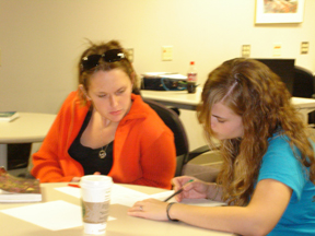 Tutor Claire Abent is working with a student.