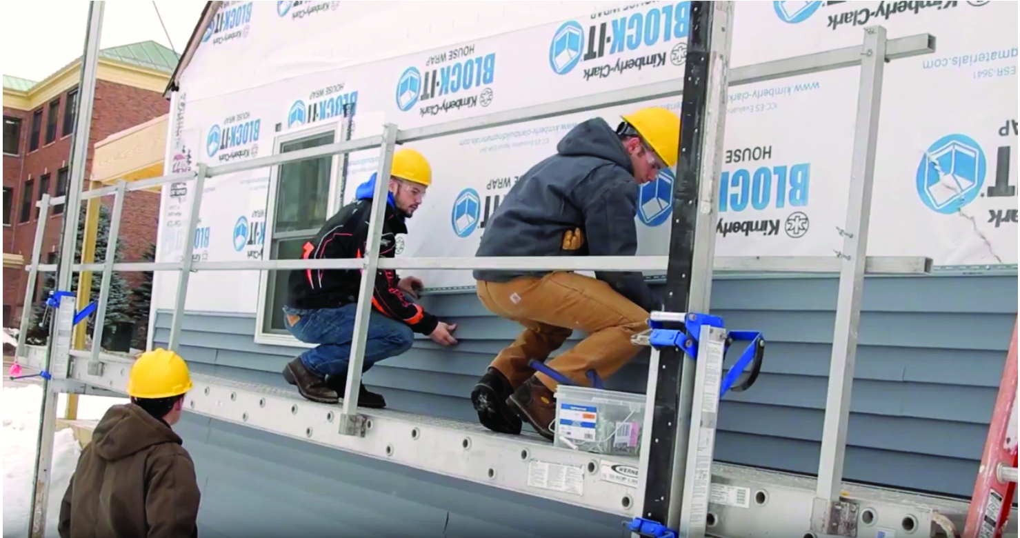 Ishpeming High School students remodel a house