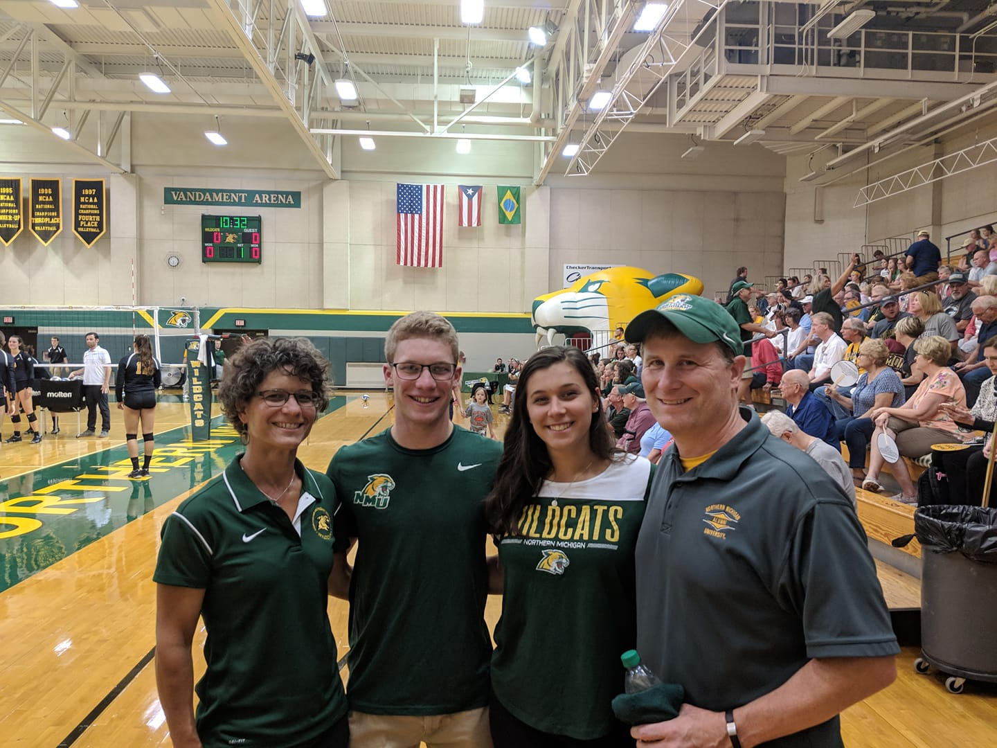 family in wildcat gear at volleyball game