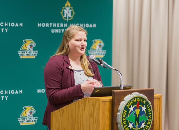 Lieck delivering her final ASNMU President's report to the NMU Board of Trustees