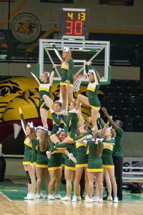 NMU cheerleading squad.
