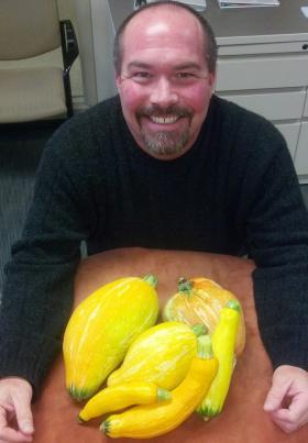 Reinhardt with his squash harvest