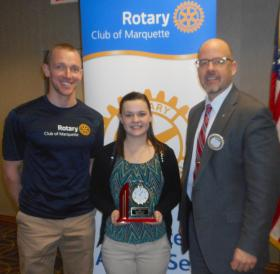 Marquette Rotary Club President Brett Conklin and Rotarian Jack Frost present Haley Knight with Rotary's Community Citizen Award.