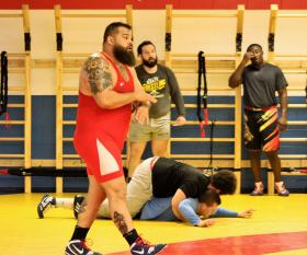 Olympian Robby Smith gives direction during an early camp at NMU.