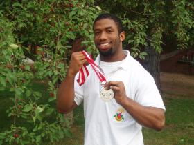 Roberts holds the silver medal he won in Peru