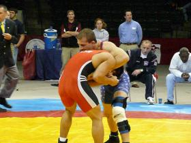 Jim Gruenwald (blue) wrestles Wang Hui