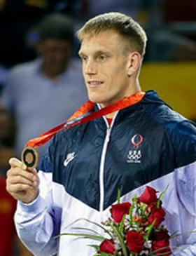 Adam Wheeler accepts his gold medal in Beijing