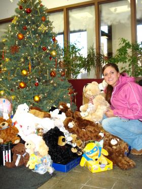 Emily Olson and some of the teddy bears collected