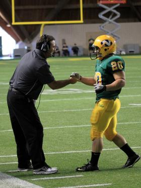 Chris Ostrowsky has been named NMU football coach.