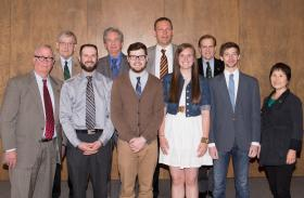 Front row (from left): NMU President David Haynes, students Poglese, Nye, Hastings and Surrell, and trustee Sook Wilkinson. Back row: Trustees Stephen Adamini, Scott Holman, Thomas Zurbuchen and Steve Mitchell.