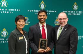 Mansoor (center) with NMU Board of Trustees Chair Sook Wilkinson and NMU President Fritz Erickson