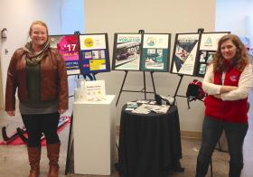 NMU student Hannah Splan (left) and UPLC Coach Tammy Wills with the three design proposals