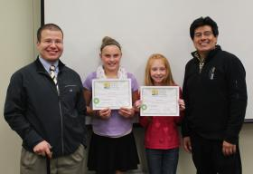 Two of the four poster contest winners with their certificates