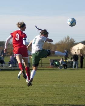 Amelia Johnson goes up for the header.
