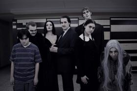 From left: Jeremiah Ogawa as Pugsley, Ryan White as Fester, Jill Vermeulen as Morticia, Devin Murphy as Gomez, Brock Weaver as Lurch, Hanna Numinen as Wednesday and Lilith Kontos as Grandma