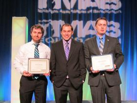 Pictured at the awards presentation at the Great Lakes Broadcasting Conference in Lansing are (from left) Nichols, Vendittelli and Holloway.