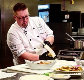 Chef Mileski preparing empanadas (Simply Superior photo)
