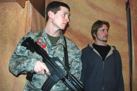 NMU alumnus Brenton Fitzpatrick (Marine) and NMU student Maxwell Peterson (Journalist) rehearse a scene from