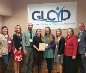 From left: In the photo are l to r:  Danielle Bain, Rachel Harris, Jon Barch, Katie Pershinske, Georgia Harrison, Hannah Lewis, Jill Rady and Dave Bonsall.