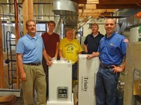 From left: From left to right: Swick Co-Owner Rick Gilles; HVAC student Eric Hanold; HVAC student Kyle Ray; NMU HVAC instructor Ross Christensen; and Swick employee Adam Lavigne