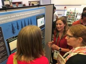 Bjornen talks to scientists about her research at the AOS/SCO conference