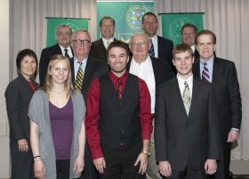 Front row (from left) Cara Crawford, Brandon Frazho and Mitchell Stephenson. Middle: Trustee H. Sook Wilkinson, NMU President David Haynes and Trustees Gil Ziegler and Steven Mitchell. Back: Trustee Stephen Adamini, Board Vice Chair Rick Popp and Trustees Thomas Zurbuchen and Stephen Gulis Jr.