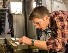 Austin Morris, student and Invent@NMU engineer, working on the product in his CNC operations class