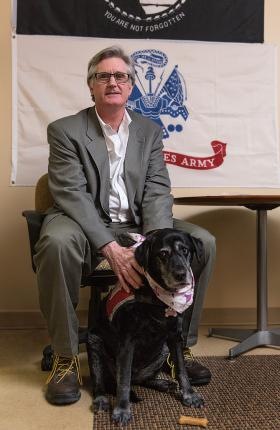 Mike Rutledge and his service dog, Onyx.