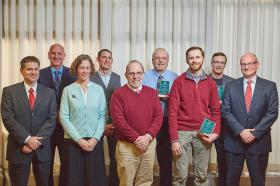 From left: Dale Kapla, assistant provost; Charles Mesloh, interim dean, Health Sciences and Professional Studies; Susy Ziegler, associate dean of Arts and Sciences and department head for Earth, Environmental and Geographical Sciences; Brian Kakas of Art and Design, Excellence in Teaching Award; NMU President Fritz Erickson; Neil Cumberlidge and Kurt Galbreath of Biology, Excellence in Scholarship; Dwight Brady of Communication and Performance Studies, Academic Service Learning Award; and Rob Winn, interim dean of Arts and Sciences. Not pictured are award recipients Christi Edge and Mounia Ziat.