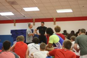 Coaches Hermann and Guenot work with athletes