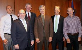 (From left): Researcher and NMU alumnus Erich Petushek; NMU President Fritz Erickson; Jeffrey Dwyer of MSU College of Human Medicine; Dr. Bill Short, community assistant dean, MSU College of Human Medicine Upper Peninsula Region Campus; Dr. Thomas Noren, chief medical officer, UPHS-Marquette; and researcher Michael Stoolmiller.