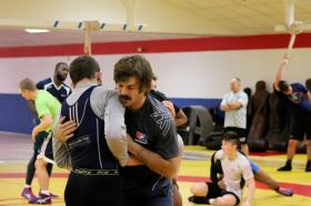 Coach Andy Bisek (front right) works with an athlete during a recent practice.