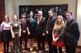 The Invent@NMU delegation with Gov. Rick Snyder before the State of the State. From left: student employees Hannah Kangas, Rachel Barra, Tony Zhuo, Rachel Griep, Snyder, John Walsh, Alexa Vander Wyst and Executive Director Dave Ollila