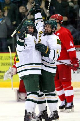 Nugent and Gron celebrate an NMU goal.