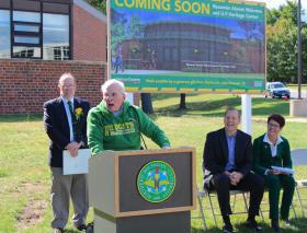 Dr. John Beaumier (at podium) with NMU President Fritz Erickson, NMU Board of Trustees Chair Rick Popp and NMU Vice President for Advancement Martha Haynes