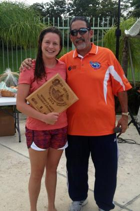 Emily Bourguignon receiving her plaque.